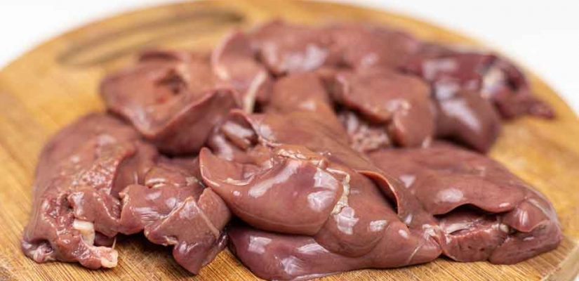 raw chicken liver on a chopping board