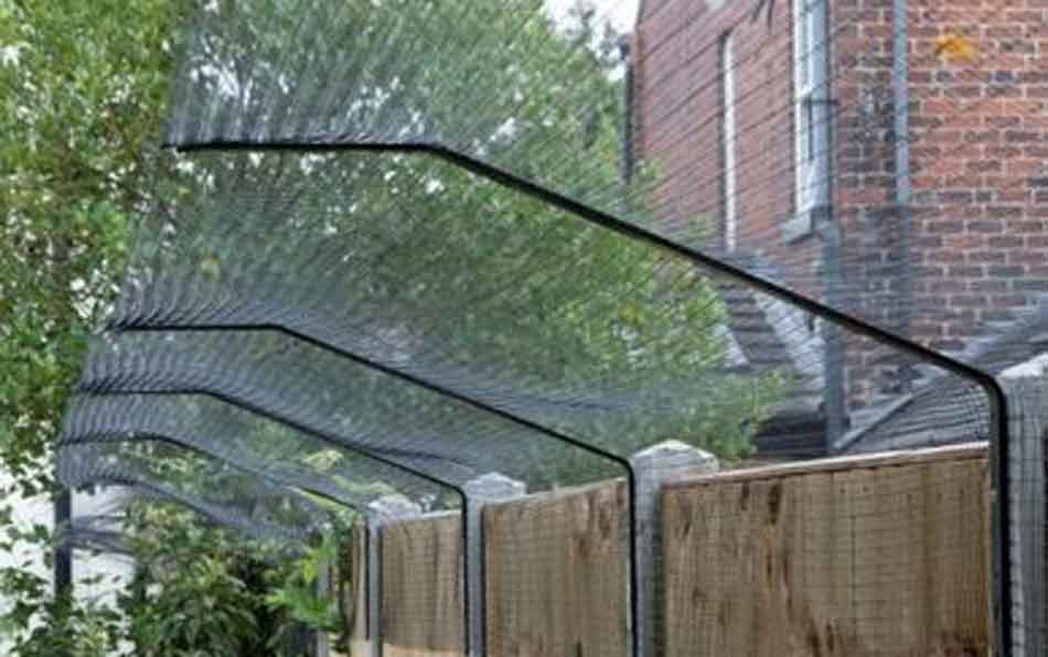 cat guard netting on a fence