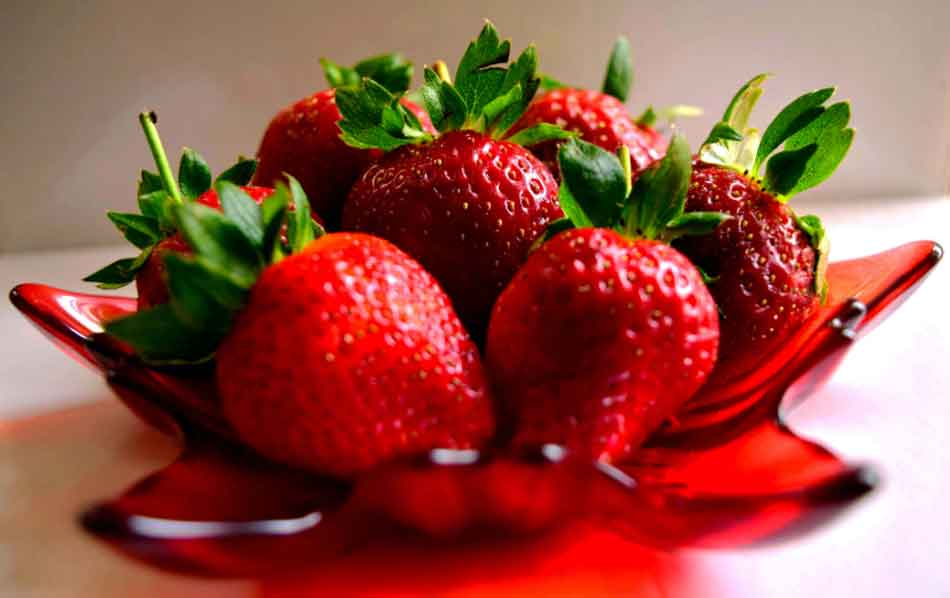 strawberries in a red bowl
