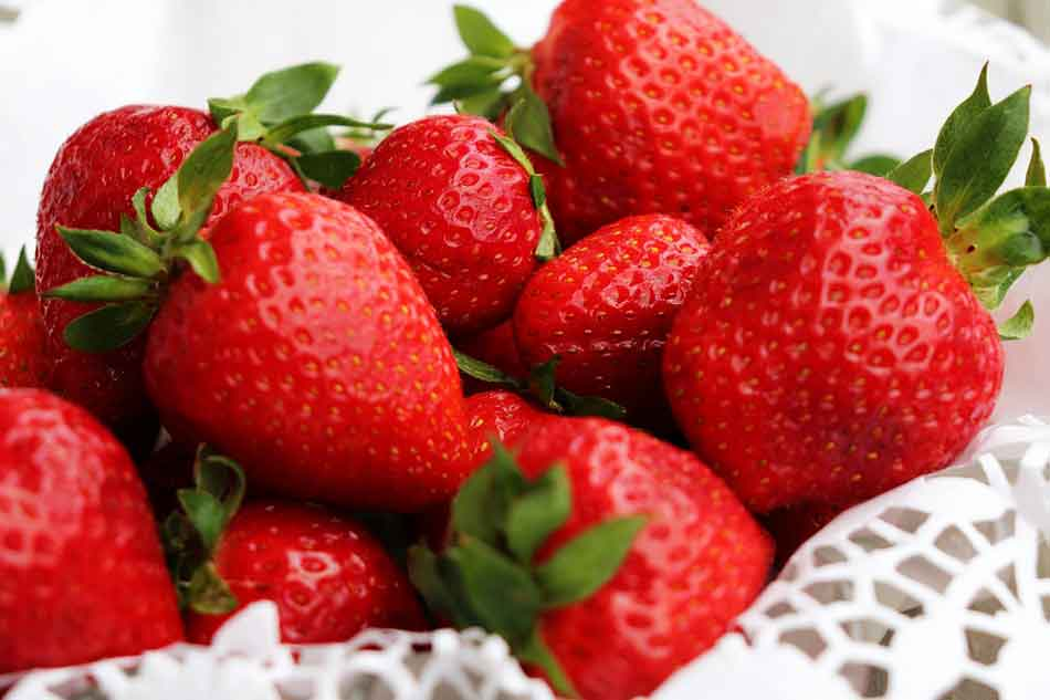 strawberries on some white cloth